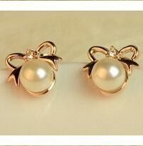 Korean fashion personality cute bow imitation pearl earrings women jewelry wholesale declared channels  free shipping
