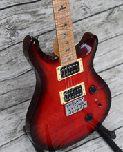 electric guitar. red burst, flamed maple neck, ash body