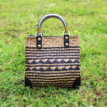 The new European and American style straw grass Baoji woven bag holiday beach package fashion Thai version of the female handbag
