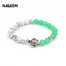 2017 male girl gift bracelet silver color sea turtle charm 8mm howlite and green quartz stone bead yoga elastic men bracelet(China)
