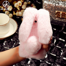 AKABEILA Fluffy Rabbit Fur Silicon Phone Case For Xiaomi Redmi 4X 5.0 inch Fashion Bling Diamond Cover Shell Back Housing(China)