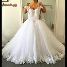 Amazing Beautiful Wedding Dress Full Of Pearls Nude Color Tulle Wedding Gown 2016