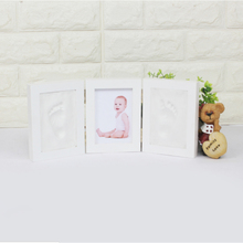 Buy 2 colors Cute Baby Photo Frame 3D DIY Non Toxic Footprint Handprint Soft Clay Safe Inkpad Home Decoration Ceremony Gift Baby for $15.79 in AliExpress store