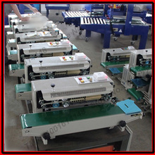 High quanlity continuous plastic bag sealing machine,automatic sealer machine steel wheel printing code(China)