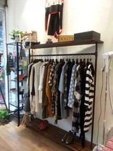 Vintage clothing display clothing store shelf floor coat rack wrought iron to do the old pipe hangers