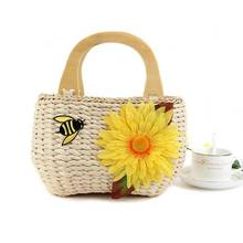 2016 new Corn skin woven summer essential flowers bees straw bag Chaomeng beach hand hand woven bag casual bag