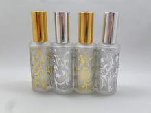 100pcs cheap 50ML wholesale frosted golden and silver glass perfume bottles with sprayer,50 ml wholesale glass spray bottles ,