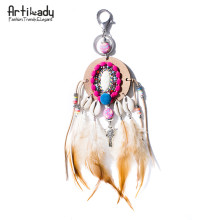 Artilady The Indias handmade bag charm boho pom feather keychain with shell key chain women jewelry gift(China)