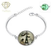 Fashion Jewellery Online Shopping New Fashion Luminous Series Silver Plated Round Pendant Marked Eiffel Tower Charm Bracelet