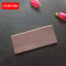 factory private customzied PU leather embossed labels sewing on clothes private label branding for jeans leather garment labels