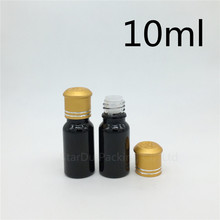 Free Shipping 600pcs 10ML Black Bottle , 10cc Vials Essential Oil Bottle with Decorative pattern cap Perfume glass bottles(China)