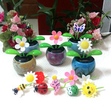 Wholesale Price Dancing Under Full Light No Battery No Water Colored Drawing Pot Solar Rocking Flowers Style Magic Toys(China)