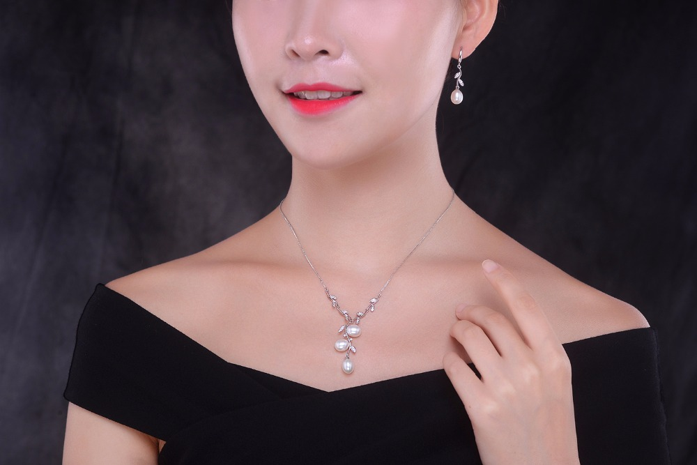 drop earring and necklace sets in silver