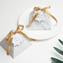 Hot sell newest tri angle wedding chocolate packaging box with printing small name tag and ribbon(China)