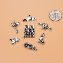 7pc mixed Antique Silver Charm Pendants Weapon pistol bullets Jewelry Making Findings DIY Charms Handmade(China)