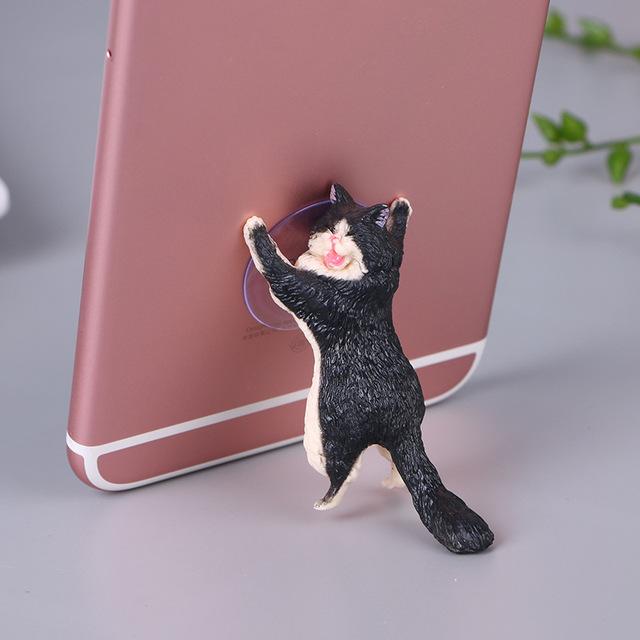 Phone-Holder-Cute-Cat-Support-Resin-Mobile-Phone-Holder-Stand-Sucker-Tablets-Desk-Sucker-Design-high.jpg_640x640 (1)