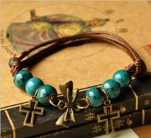 Free shipping 2017 new arrival Vintage cute round beads cross bowknot jewelry manufacturers wholesale boutique bracelet bangle(China)