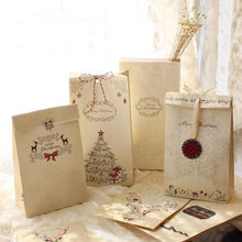 8pcs Christmas Kraft Paper Bag + stickers +rope+ Ornaments Gift Favor Supplies Bags