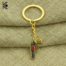 Kefeng Sunset Riders Gun Key Ring For Man Key Chain Western Cow Boy Key Finder Key Holder Golden Alloy Jewelry Sale Discount