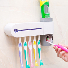 Newly Automatic Toothpaste Dispenser Squeeze Toothbrush Sterilizer Toothbrush Holder Cleaner Antibacteria Uv Light Bathroom Set(China)