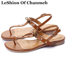 LeShion Of Chanmeb luxury brand golden metal lock deco women flat sandals black white brown female rivet shoes casual sandals 43(China)