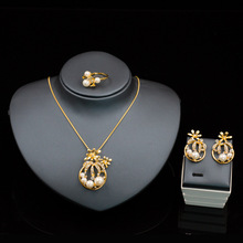 Popular in Europe Alloy imitation pearl suite African beads jewelry set Necklace earrings ring three-piece set AD1421