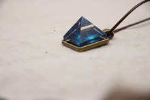 2017 New Fashion Glowing Crystal Glow in the Dark Pyramid Pendant Necklace Outer Space Star Dust Geometric Magic Necklace Gift(China)