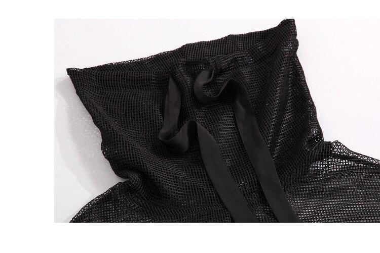 Suurte taskutega võrgust pluus