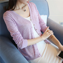 the Korean version of the new spring and summer long sleeved knit shirt thin hook flower hollow solid small cardigan