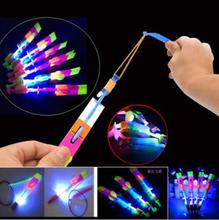 50pcs Amazing LED Light Arrow Rocket Helicopter Flying Toy Party Fun Gift