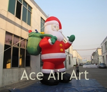 huge inflatable Santa Claus taking  presents to children for decoration