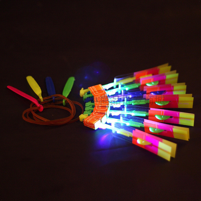 1 Pieces LED Flying Arrow Helicopter Flying LED Umbrella Toys LED Light Up Toy Rocket Slingshot Toys Cheap Toys(China (Mainland))