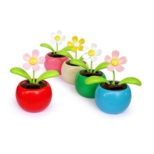 Hot Solar Powered sunlight power Flip Flap leaves Flower Flowerpot For Car Swing automatic Flower Toy Gift(China)