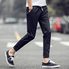 The spring of 2017the new youth fashionable pure color leisure trousers nine minutes of pants big feet pants grey/black bag mail