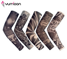 FreeShipping 5 PCS New Mixed 92%Nylon Elastic Fake Temporary Tattoo Sleeve Designs Body Arm Stockings Tattoo For Cool Men Women(China)