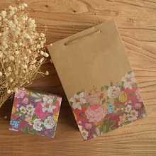 10pcs/lot kraft paper bag with flower handle / wedding party bag /Fashionable cloth shoes gift paper bags colourful printing(China)