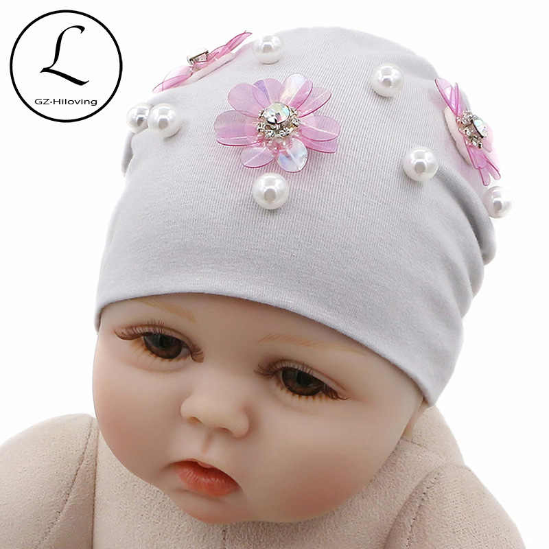 GZHilovingL New Born Baby Hats Solid Spring Autumn Winter Newborn Flower  Baby Beanies Hat Cotton Infant c96730e7d46
