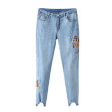 Europe and the United States 2017 light floral embroidery waist elastic thin jeans foot gap irregular pencil pants