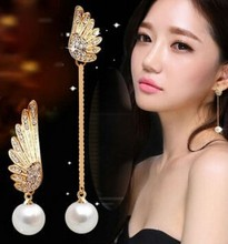 Korean fashion personality asymmetric imitation pearl angel wings delicate earrings wholesale influx of people female(China)