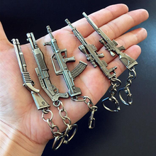 13 Styles Simulation Weapon Model Keychain Mini M4A1 AK47 Gun Key Chain Car Keyring AWP Rifle Sniper Cool Mens Key Cover Jewelry(China)