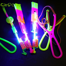 1pc  make LOGO blue light Novelty kids LED flying toys led slingshot amazing arrow helicopter party supply