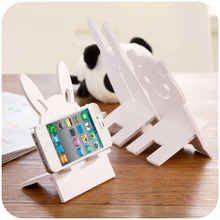 vanzlife Creative cute cartoon lazy mobile phone holder pure white shelf wood-plastic board material, thick and durable(China)