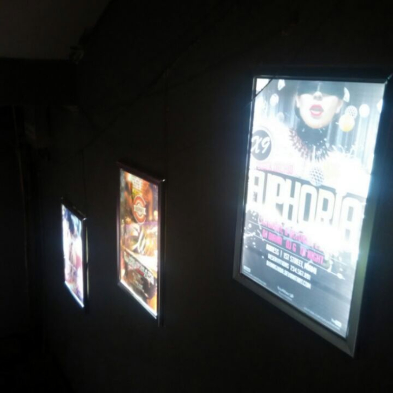 Lighted movie poster frames home theater