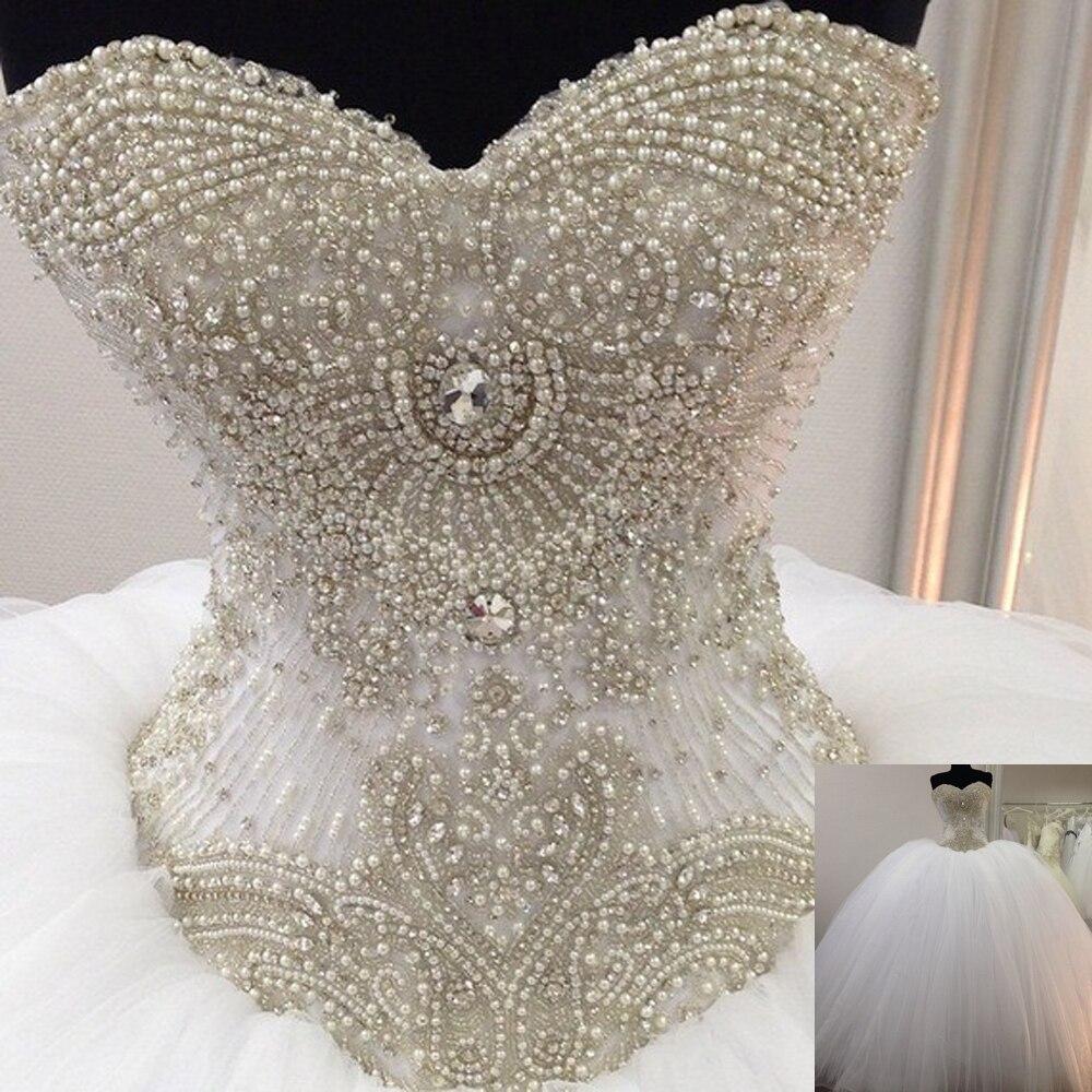 Свадебное платье с вышивкой жемчугом