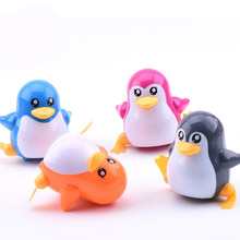 Free Shipping 1 PIECES New Lovely Funny Children Kids Toy Walk Penguins Clockwork Wind Up Party Toy W20