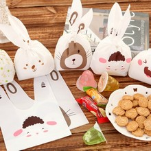 20pcs/lot Cute rabbit ear cookie bags Self-adhesive Plastic Bags for Biscuits Snack Baking Package food bag party send random(China)
