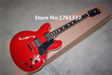 Factory custom semi-hollow red double f holes electric guitar with flame maple veneer,black pickguard,can be changed as request