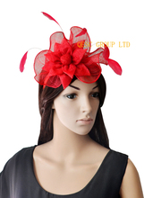 Red fascinator sinamay feather fascinator.