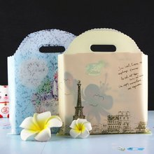 Buy 3 give 1 free Hot Sale Lacework style Wholesale 25pcs Eiffer Tower Shopping Bags Plastic Gift Bags clothing bags