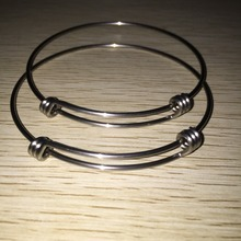 100pc) Wholesale Trible Time Twisted 65mm Diameter Simple Stainless Steel Material Wire Expandable Bangles(China)